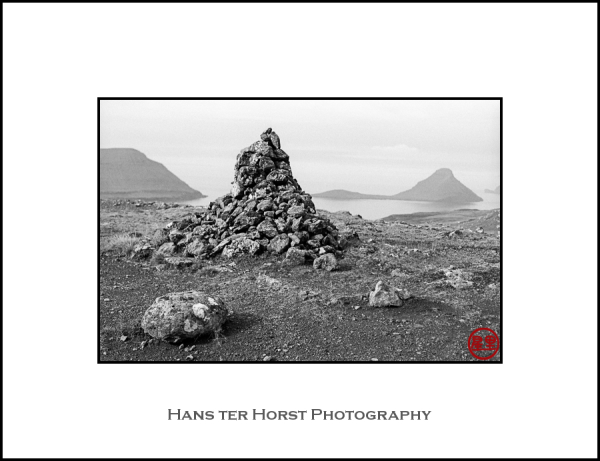 Faroe: cairn with Koltur Island in the background