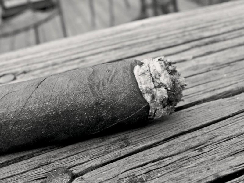 Smoking a cigar on my deck.