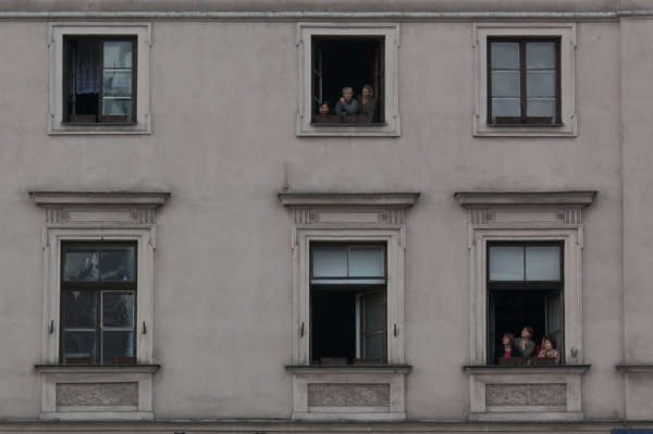 Polish people watching their president.