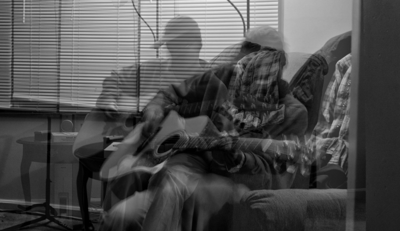 A friend playing guitar.