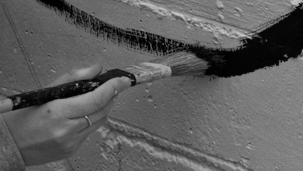 Painting a mural to fight graffiti.