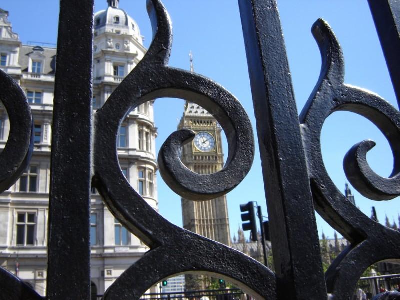 Big Ben, as seen from behing Westminster railings.