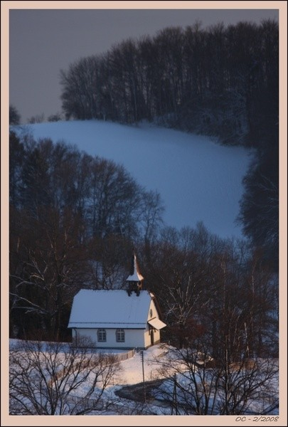 small church in the snow light sunset