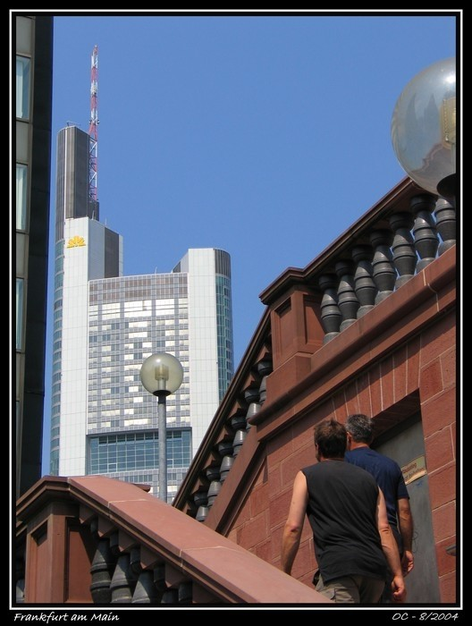 buildings in frankfurt with passer-by people