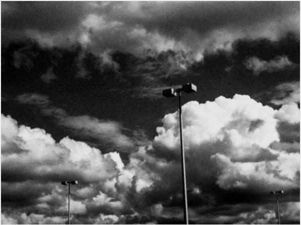 light lightpoles standards cloud clouds sky storm
