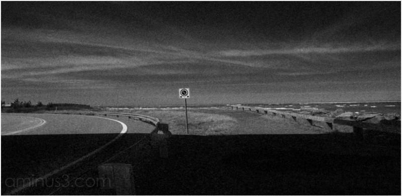 warning sign coast icepans curve underpass shadow