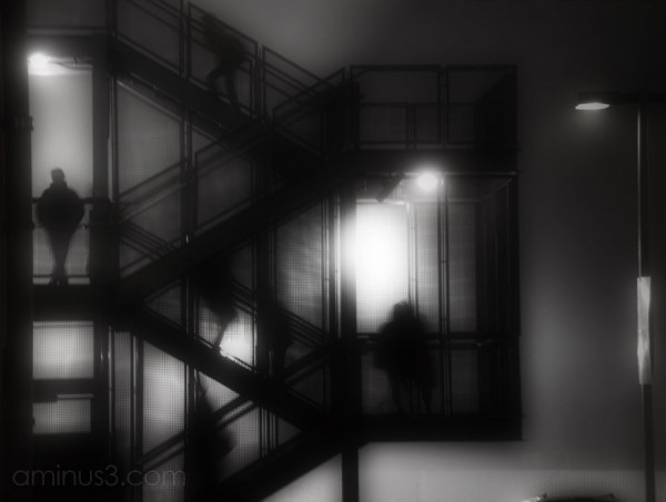 silhouettes of people on stairway at night