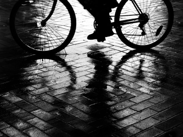 bicycle in the rain with reflections, wet pavement