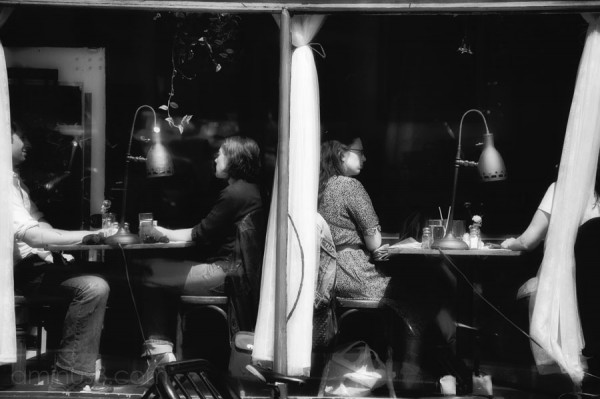 people sitting in a cafe window