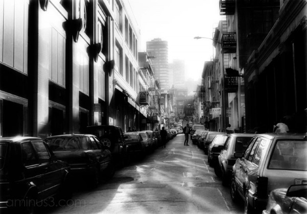 car lined street in SanFrancisco fades to fog