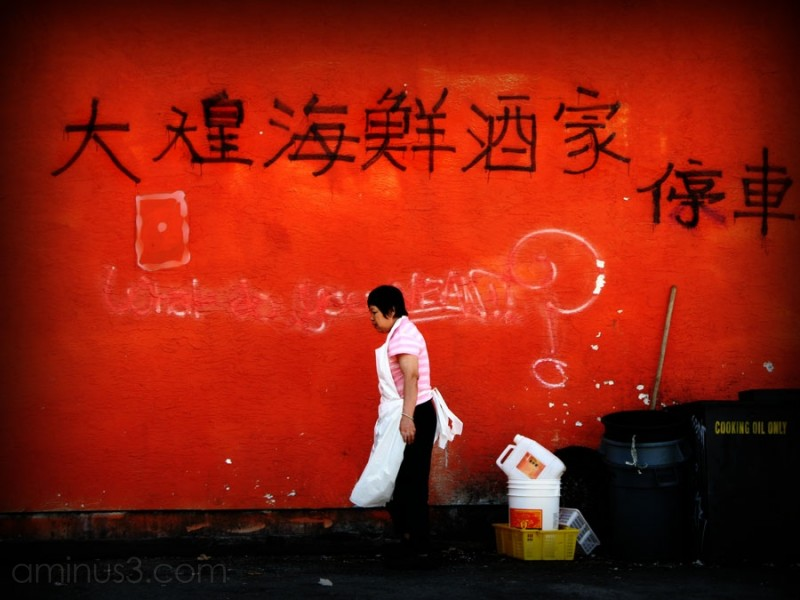 woman in back alley chinese characters on wall