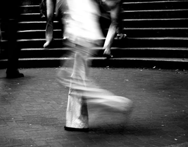 blurred man dancing in streeet