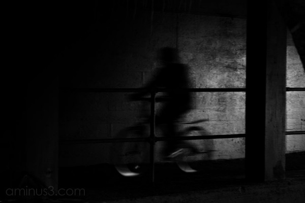 man riding a bike appear ghost-like