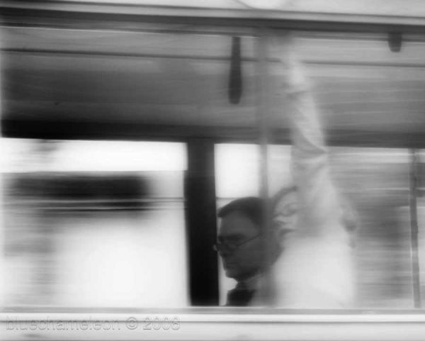 2 people in a window of bus in motion