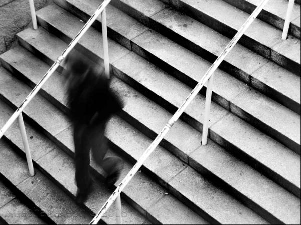 a blurred man walking down stairs