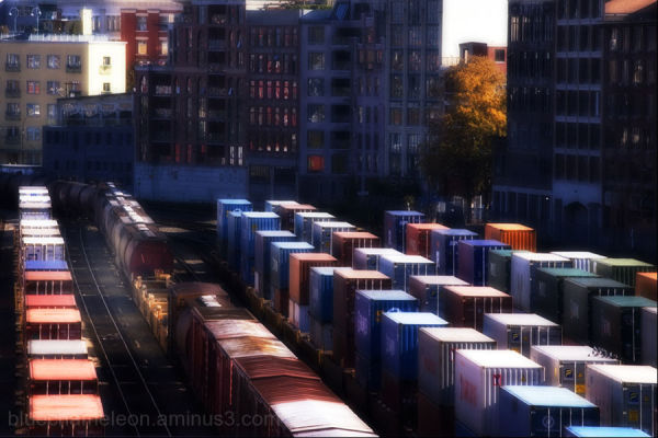 colour containers in a railway yard with city