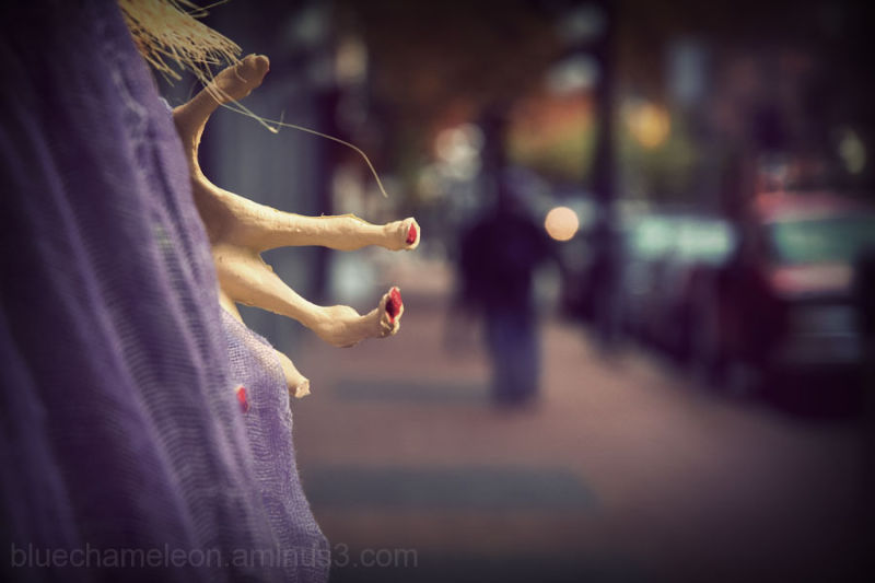 A witches hand reaching out for a man on street