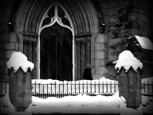 Church doorway with snow coming down, ghostly
