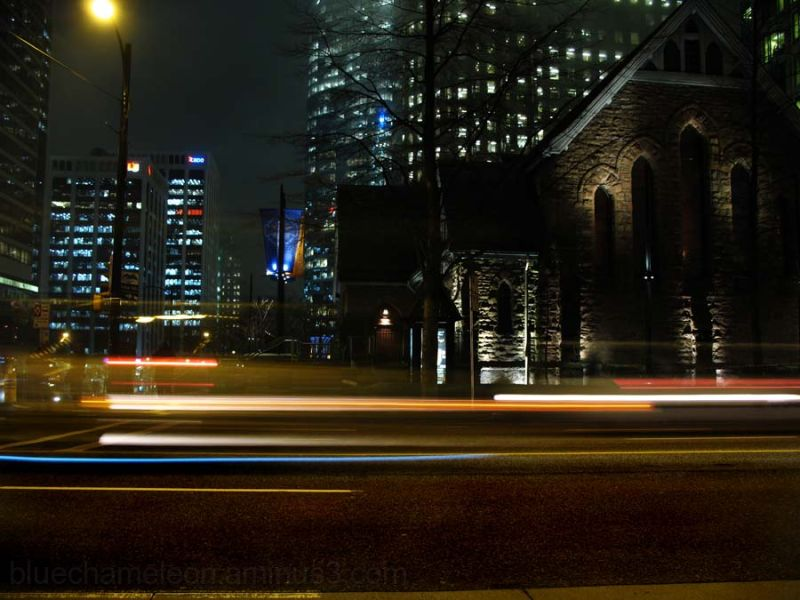 Church & city at night, cars rushing by