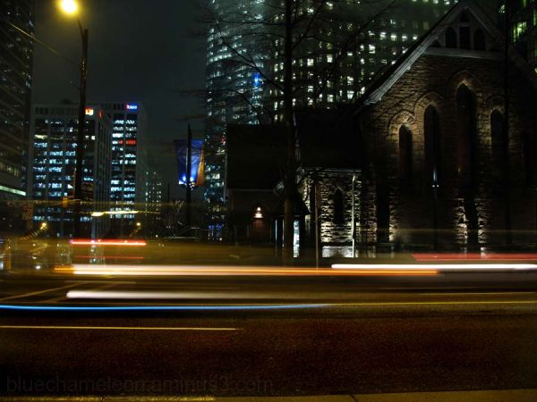 Church & city at night, cars rushing by
