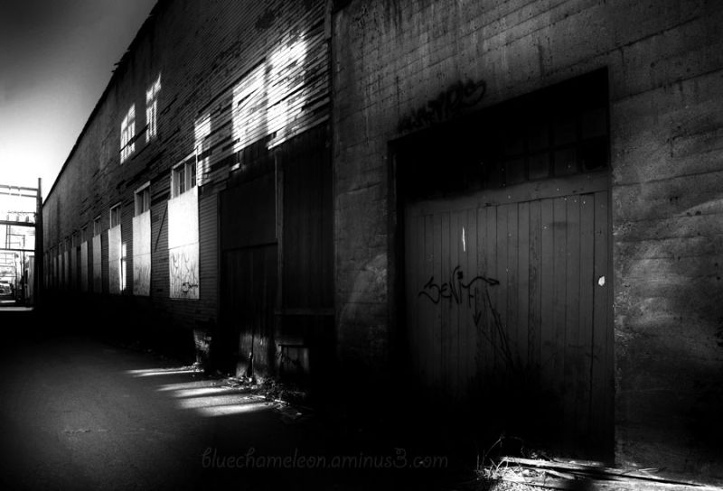 A back alley in bright sun and heavy shadow