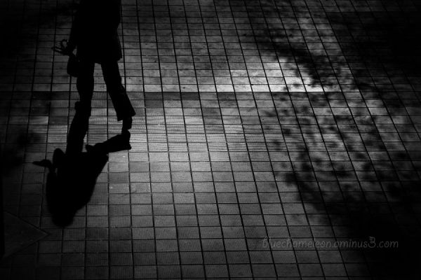 A silhouetted woman with shadows at station