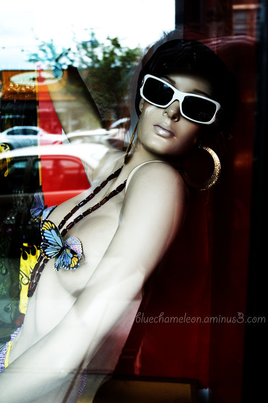 A mannequin with butterflies on her breasts