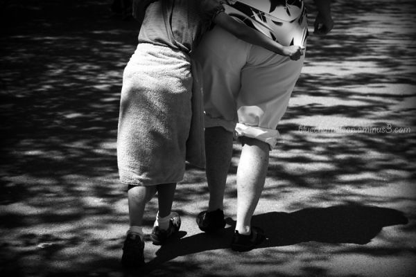 Mother & child walking into shadows