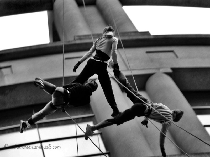 3 people falling with ropes from top of library