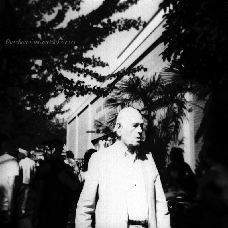 A man in white and high contrast on a city street
