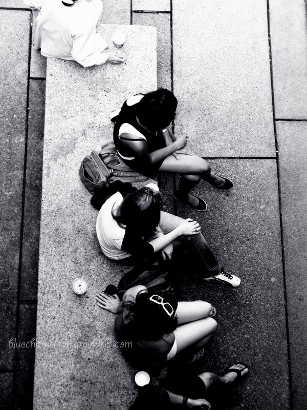 A group of women shot from above, on a bench.