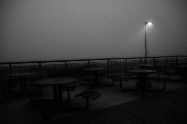 An outdoor empty beach cafe in fog