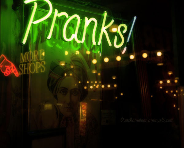 Fortune teller reflected in window of Pranks!