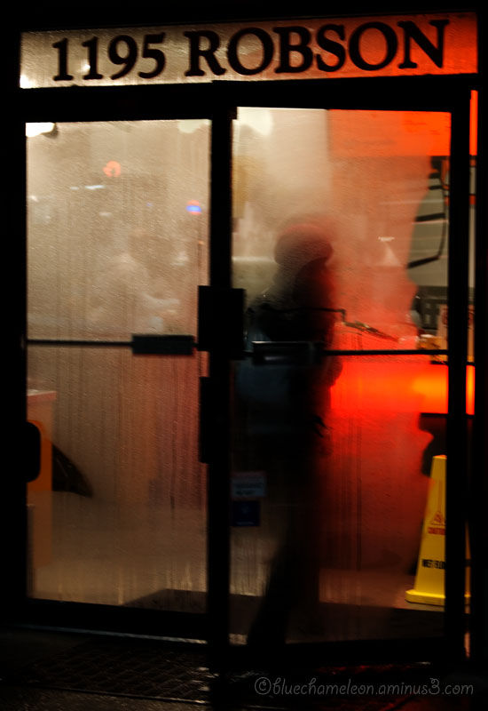A person walking into a steamy store front.