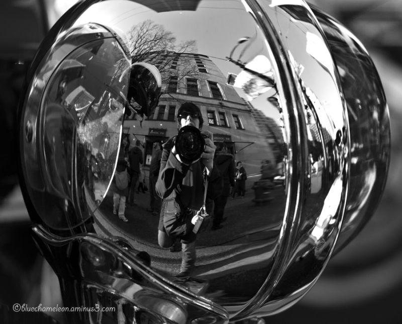 Warped self portrait reflection of city