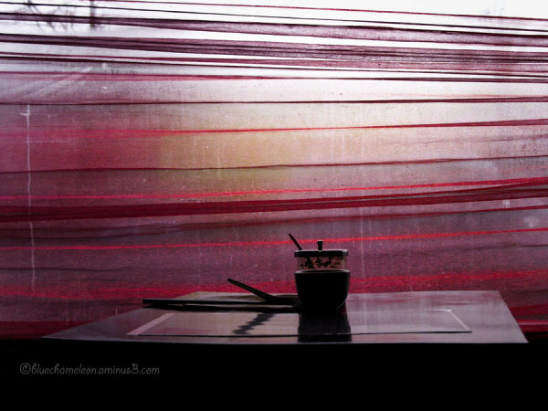 An empty table against window in asian restaurant