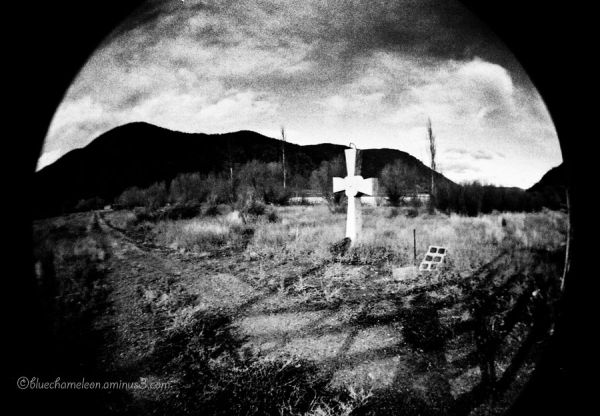 A head stone along a lone country road