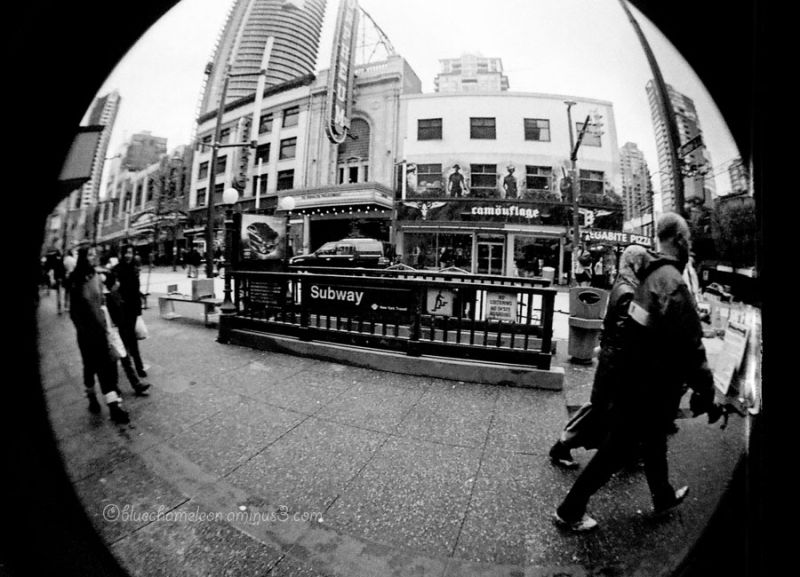 People walking along Granville Street by subway
