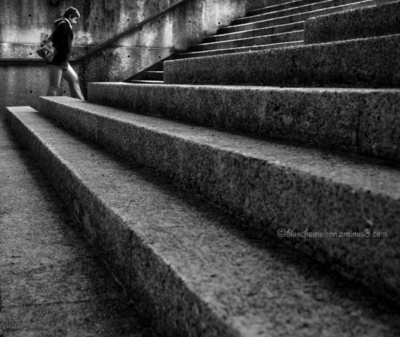 Low view of stairs and woman walking up them