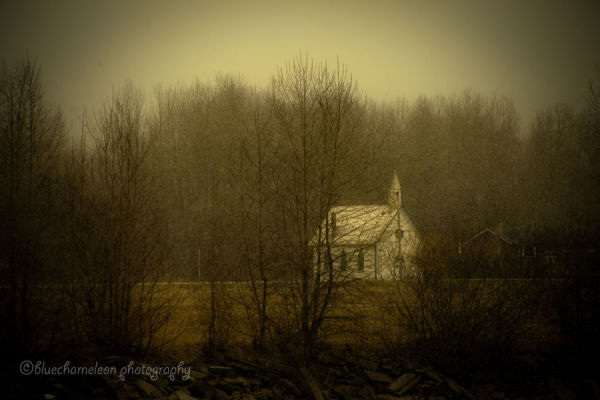 A little church in the woods during a snow storm