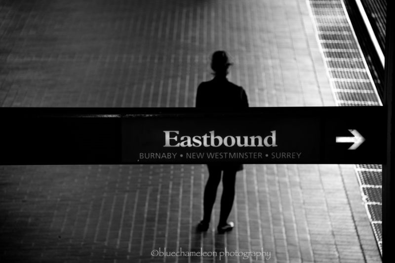 Silhouetted woman at an Eastbound train station