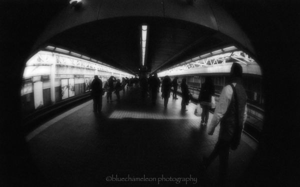 fisheye view of people in a train station