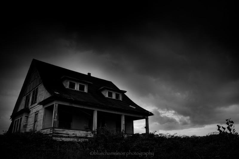 A lone haunted house on rural road