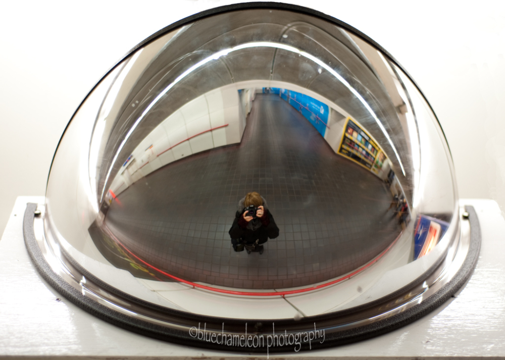 self portrait in fisheye mirror in station