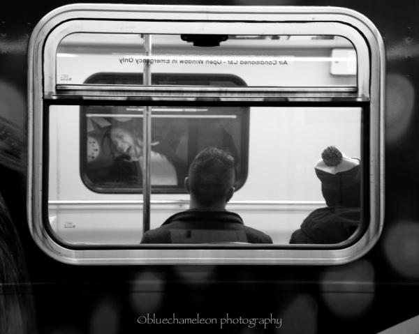 Billboard of woman looking at men on train