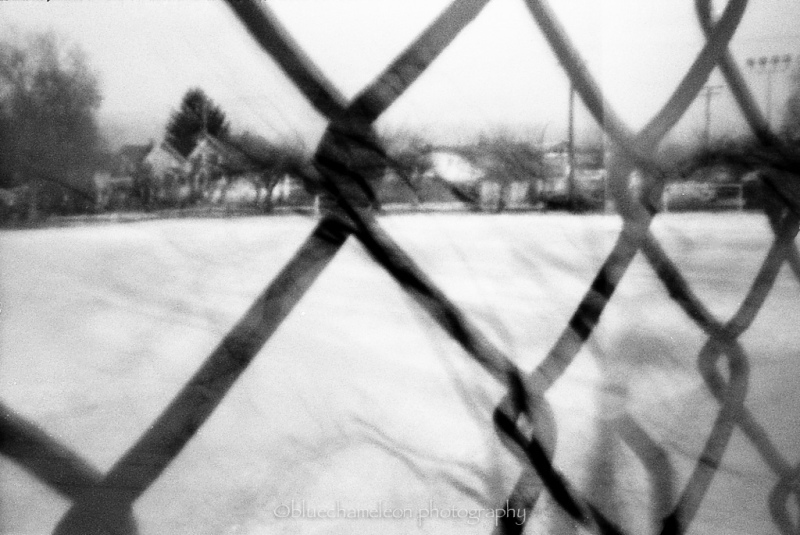 Pinhole photo shot through a fence