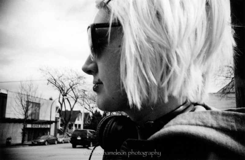 Profile of a woman on the street with headphones