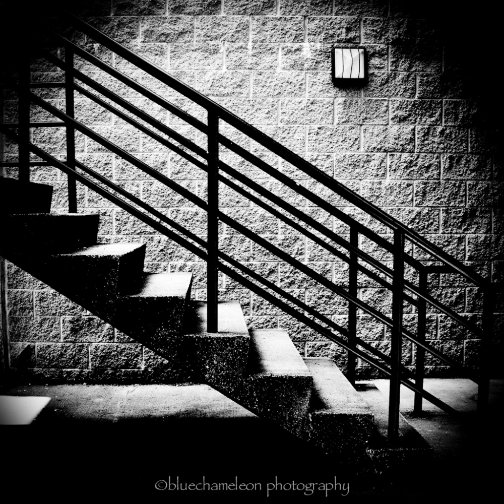 Stairway against a brick wall, high contrast