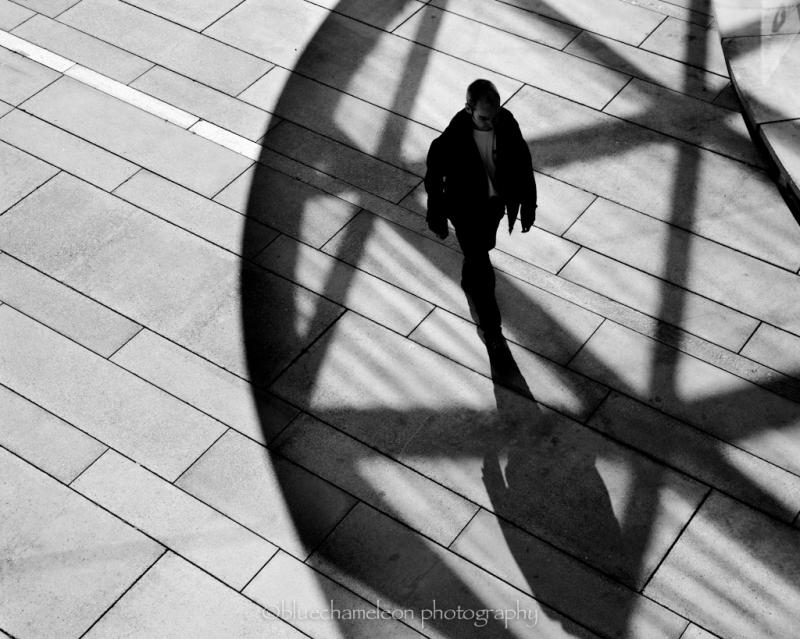 A man walking through shadows