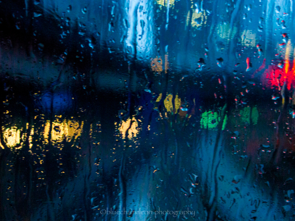 Rain drops on a window with bokeh lights